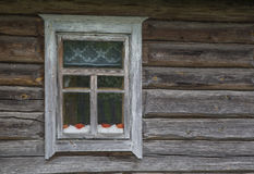 Old rustic window. Large fragment of the old village window. done manually Royalty Free Stock Image