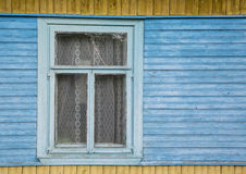 Old rustic window. Large fragment of the old village window. done manually Stock Photo