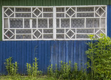 Old rustic window. Large fragment of the old village window. done manually Stock Photos
