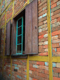 Old rustic window. Textured old flat brick and stone wall with window Royalty Free Stock Photo