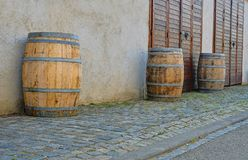 Old rustic wine barrels in front of modern wine cellar. Wine background in Europe. Czech Republic, South Moravia.  royalty free stock image
