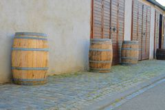 Old rustic wine barrels in front of modern wine cellar. Wine background in Europe. Czech Republic, South Moravia.  stock photo