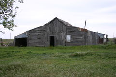 Old Rustic Wooden Barn in Field Stock Photography