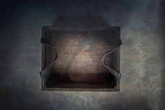 Old Rustic Wooden Box over Grunge Textured Background. Old rustic wooden box with leather straps over a dark background. Image shot from above royalty free stock photo