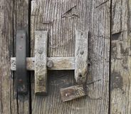 Old rustic wooden door latch. Royalty Free Stock Image