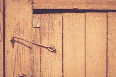 Old rustic wooden door locked with hook Royalty Free Stock Image