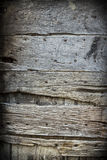 Old rustic wooden door. Photo of an old worn wooden door in Italy Stock Images