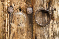 Old rustic wooden door with a ring handle Stock Photography