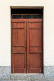 Old rustic wooden doors. Old rustic wooden gate painted in brown Stock Photography