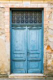 Old rustic wooden doors painted in blue. Old rustic wooden gate painted in blue Royalty Free Stock Image
