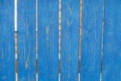 Old rustic wooden fence with shabby blue paint stock photos