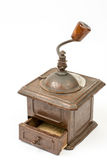 Old rustic wooden hand mill for coffee and spices Royalty Free Stock Photo