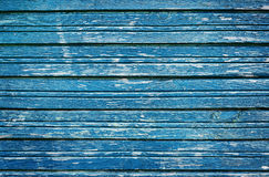Old rustic wooden planks with blue cracked paint, vintage wall wood for background. Carpentry Stock Photo