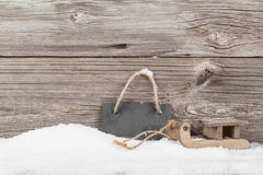 Old rustic wooden sledge, over snow Royalty Free Stock Images