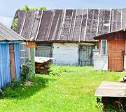 Old rustic yard. With rickety houses and outbuildings Stock Image