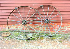 Old and rusting steel wagon wheels Stock Photo