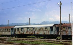 Old rusting train carriages. Abandoned old railway carriages on dead line, with peeling paint and rust Stock Image
