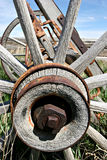 Old rusting wagon wheel. An old wooden wagon wheel in wyoming Stock Photo