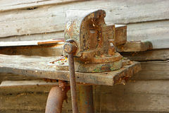 Old rustu all-steel vice on obsolete wooden Royalty Free Stock Photos