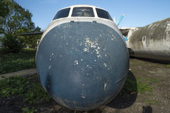 Old rusty abandoned airplanes. Front close-up view Stock Photos