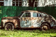An old rusty abandoned car outdoors broken Royalty Free Stock Images