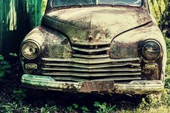 An old rusty abandoned car outdoors broken Royalty Free Stock Photo