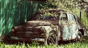 An old rusty abandoned car outdoors broken Stock Photography