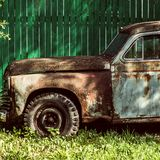 An old rusty abandoned car outdoors broken Stock Photos