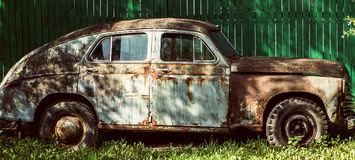 An old rusty abandoned car outdoors broken Stock Images