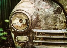 Old rusty abandoned car outdoors macro Stock Images