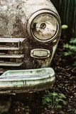 Old rusty abandoned car outdoors macro Stock Image