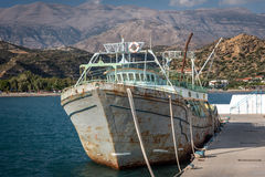 Old rusty abandoned cargo ship at port of Aghia Galini on Crete island Stock Image