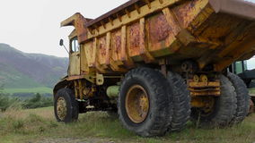 Old rusty abandoned dump truck close up stock footage