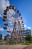 Old rusty abandoned Ferris wheel in the amusement park in Ochamchira, Abkhazia stock image