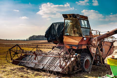 Old rusty abandoned harvester on a country field Royalty Free Stock Photo
