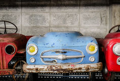 Old and rusty abandoned pedal cars for kid Stock Photos