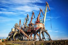 Free Old Rusty Abandoned Port Cranes Stock Photography - 117741662
