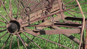 Old rusty agriculture horse rake tool in spring farm stock video