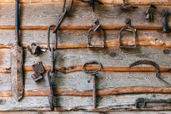 Old rusty agriculture objests. Set of old rusty  objects on a wooden background. A concept on excavation, archeology, farming, the Ukrainian culture themes Royalty Free Stock Photo