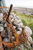 Old rusty anchor. On sea coast background Royalty Free Stock Photography