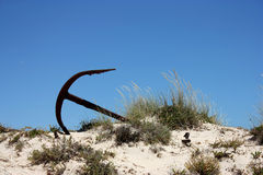 Old rusty anchor on a beach Royalty Free Stock Photos