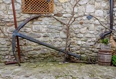 Old rusty Anchor. In old city Stock Photos