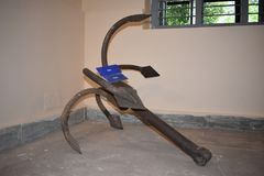 Old rusty anchor on ground. An old rusty anchor at Odisha state museum, Cuttack, Odisha, India. This anchor helps to stop the boat, ship. One chain is required stock photos