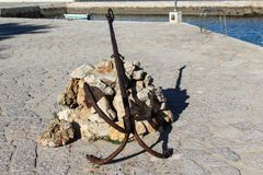 Old rusty anchor in the habor. In Lagos city in Portugal Royalty Free Stock Photo