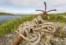 Old rusty anchor and rope, Newfoundland Stock Photo