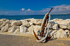 Old rusty anchor by the sea Royalty Free Stock Photo