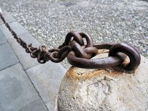 Old rusty anchored Iron Chain Royalty Free Stock Images