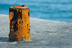 Old rusty attachment in port. Old rusty attachment for the berthing of ships in port Royalty Free Stock Photos