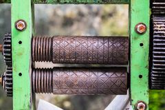 Old rusty axle shaft of sugarcane juice machine manual. In Yangon, Myanmar royalty free stock image