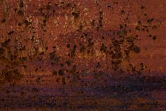 Old rusty background with dark spots royalty free stock photo